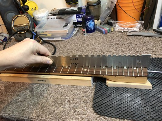 Checking how level the fretboard is