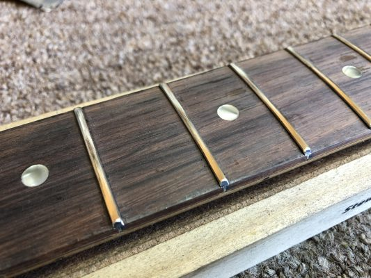 Frets crowned, polished and edges rounded