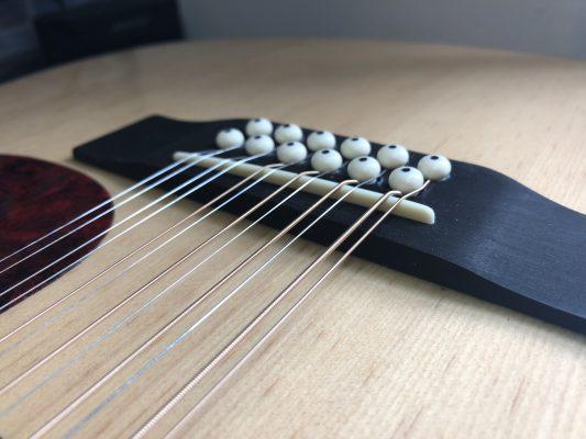 Bridge Radius Now Matches Fingerboard