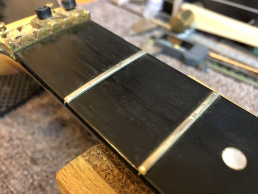 Pitted, worn frets