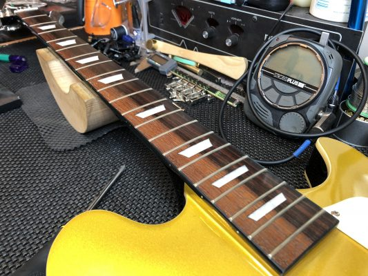 The frets are tarnished
