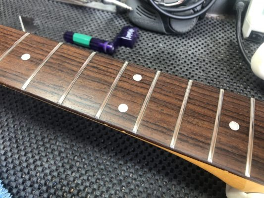 Polished frets, conditioned board