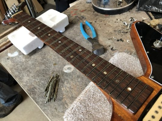 Fretboard ready to be levelled.