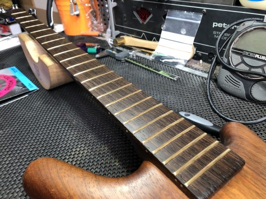 Cleaned and oiled fretboard