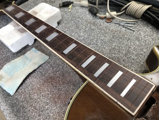 Gap filled, fretboard levelled