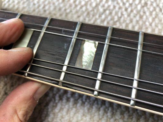 Fret pushed into fingerboard