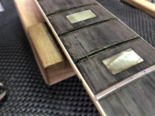 The damage from the fret.