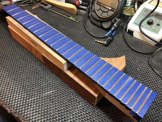 Crowned and polished frets