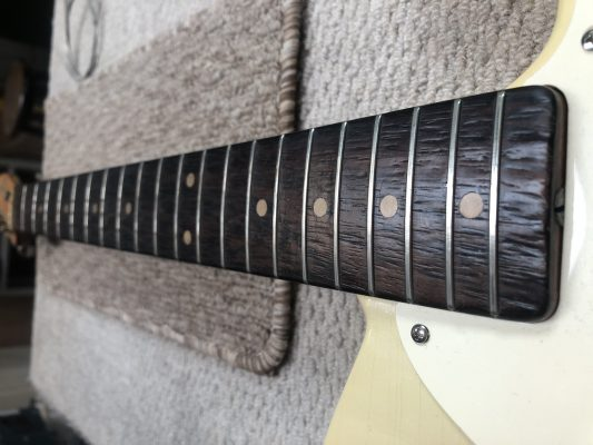 Pitted fretboard