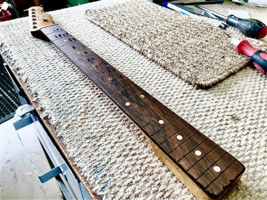 Levelled fretboard