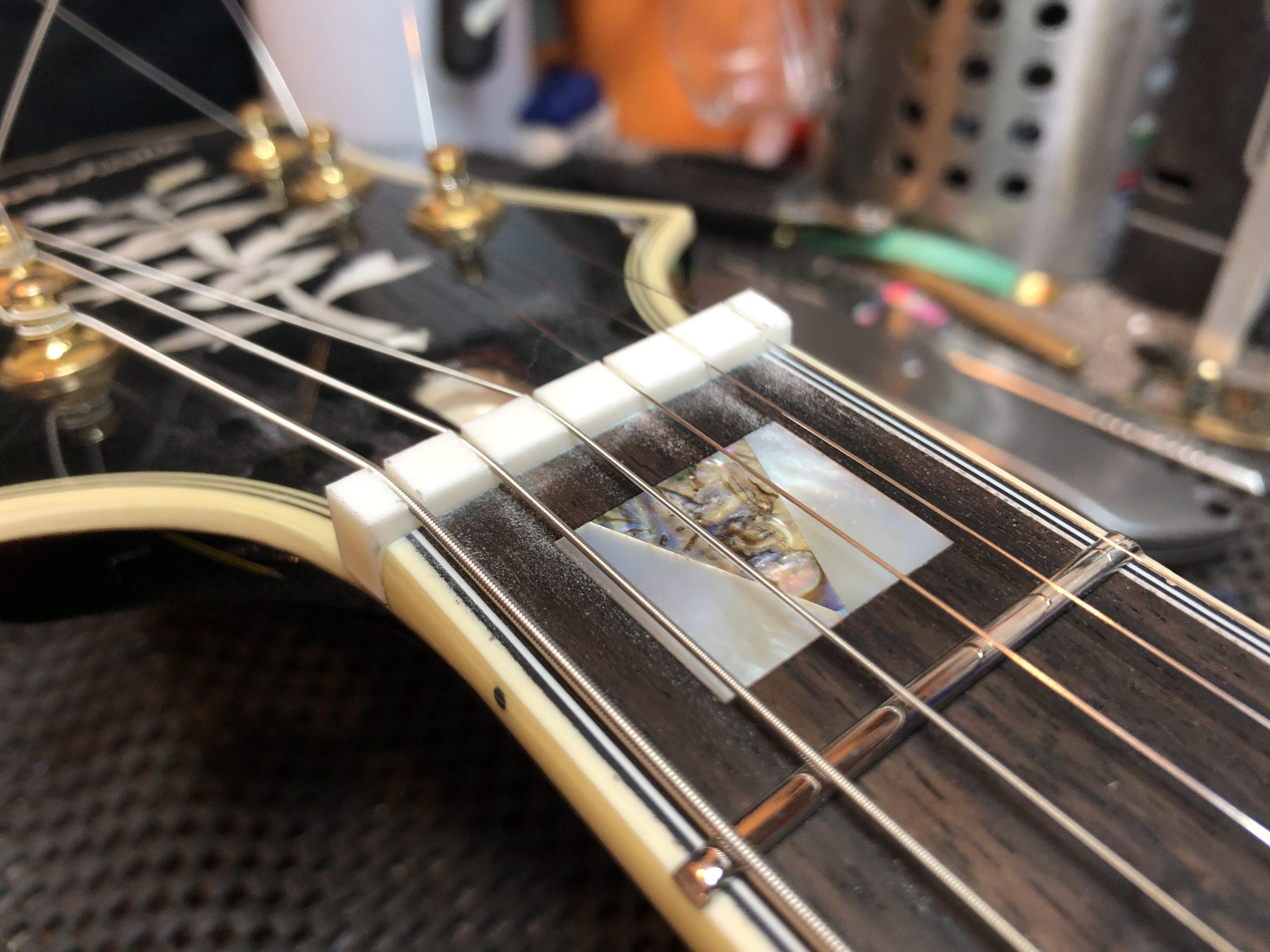 Cutting string slots