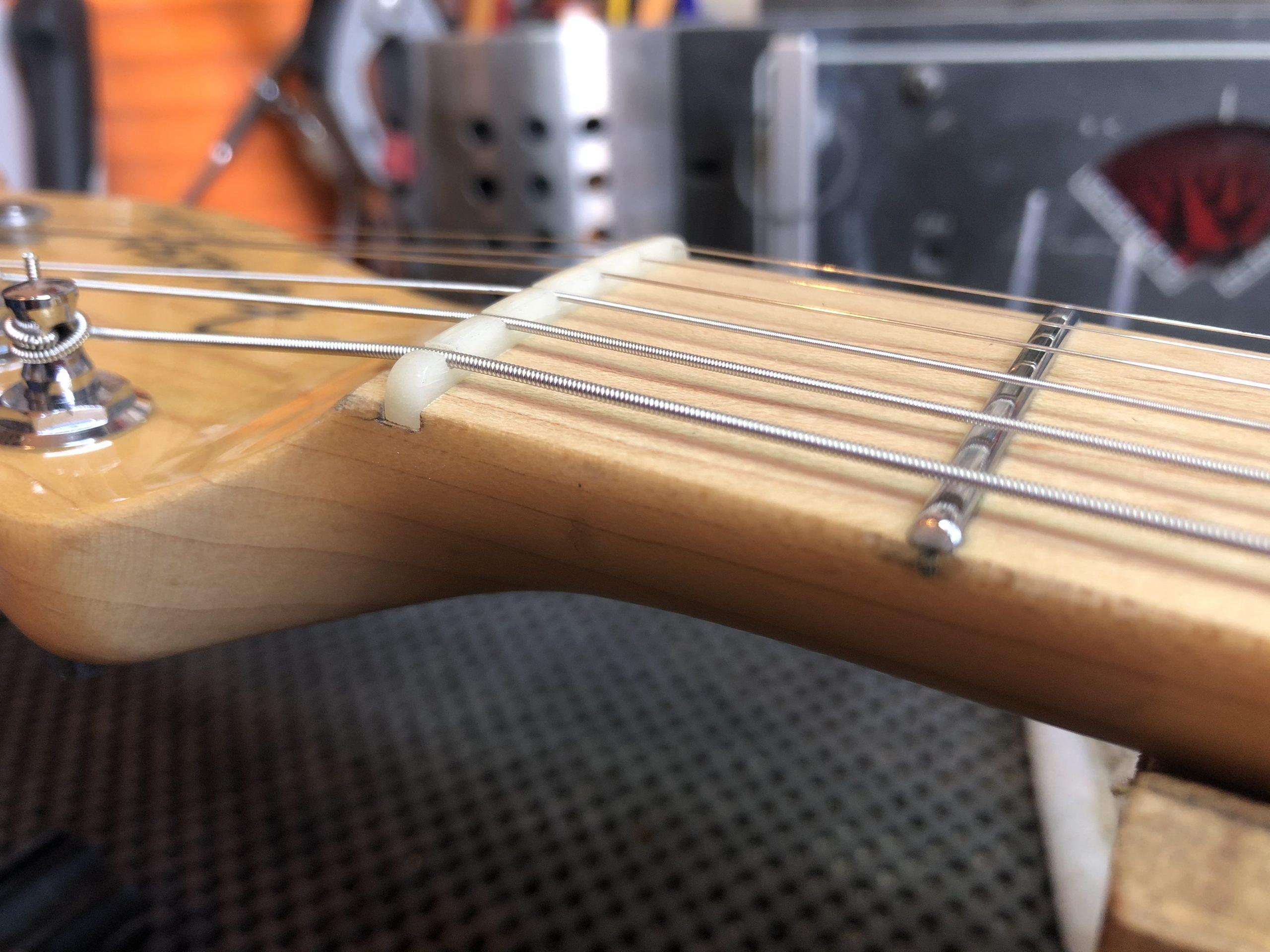 String hight at nut set