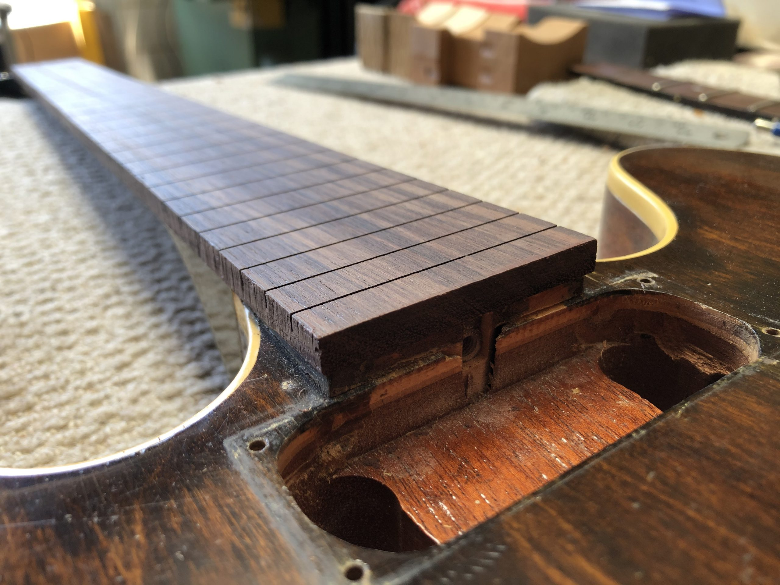 Fretboard fitted