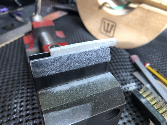 Cutting string grooves
