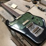 Russian Guitar has Truss Rod installed and a new Fingerboard.